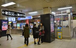 Passagers gather in the train station in Kyoto Stock Photos
