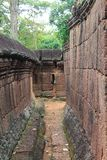 Passage through ruins at Banteay Srei, Cambodia Stock Images