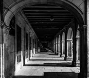 The  passageway. Passageway in black and white taken in a square of Pamplona, Spain Stock Image