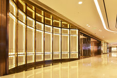 Passageway of commercial building. Passageway of modern commercial building lit by led light belt Royalty Free Stock Images
