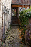 Passageway fall scenery. Open iron gate of a passage in the urban area of Hilpoltstein, Germany, at fall Stock Photo