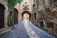 Passageway in Pals. Passageway in the old town of Pals in Girona, Catalonia Royalty Free Stock Images
