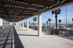 Passageway at Port Olympic in Barcelona Stock Photos