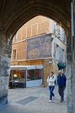 Passageway to the city hall place in Aix. AIX-EN-PROVENCE, FRANCE, April 6, 2018 : Old town lies to the north of Cours Mirabeau with irregular streets and old Stock Photography
