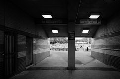 Passageway to sports arena in black and white Stock Photo