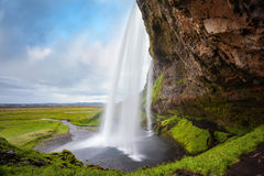 Passaggio sotto la cascata Seljalandsfoss Fotografia Stock Libera da Diritti