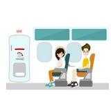 Passagier, der an Fensterplatz und Notausgang sitzt Lizenzfreie Stockbilder