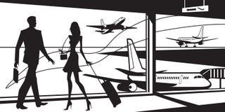 Passagiere im Flughafenwarteraum Lizenzfreies Stockbild