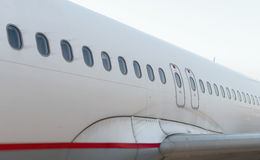 Passagierflugzeugfenster Stockfoto