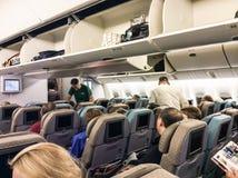 Passagiers in het vliegtuig Stock Fotografie