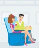 Passagiers in vliegtuig Stock Afbeeldingen