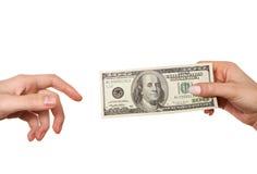 Passando o dinheiro Fotografia de Stock