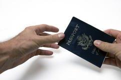 Passando o passaporte Fotos de Stock Royalty Free