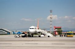 Passanger airplane at airport runway Royalty Free Stock Image
