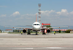 Passanger airplane at airport runway Royalty Free Stock Images