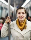 Passanger de la muchacha que se coloca en metro fotos de archivo libres de regalías