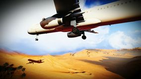 Passanger plane over sahara Royalty Free Stock Photos