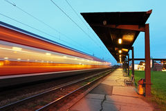 Passanger station with motion train Royalty Free Stock Images
