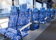 Passanger train car interior. Interior of an empty passenger train car - Row of seats wihtout folding tables Stock Photography