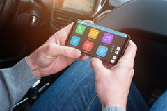 Passanger use mobile phone and app to help the driver find the desired location.  Stock Photos