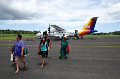 Passangers getting out of Pacific Sun airplane, Labasa airport, Stock Image