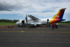 Passangers getting out of Pacific Sun airplane, Labasa airport, Royalty Free Stock Photos