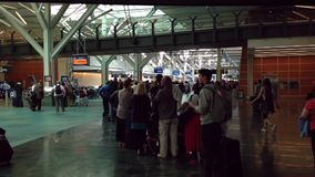 Passangers long line up for waiting check in counter at YVR airport Royalty Free Stock Image