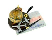 Passaporte com selos, pena, globo e aviões Fotografia de Stock