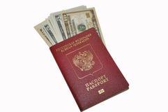 Passaporte da Federação Russa e dos dólares americanos Imagens de Stock