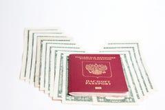 , Passaporte do russo e moeda Foto de Stock