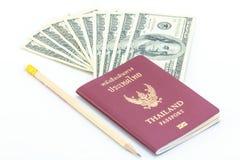 Passaporte e dólar Fotos de Stock Royalty Free