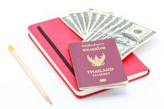 Passaporte e dólar Foto de Stock