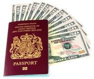 Passaporte e dólares Fotografia de Stock