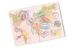 Passaporte e lote dos selos nele Isolado no fundo branco foto de stock