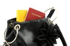 Passaporte em um saco Fotografia de Stock Royalty Free