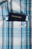 Passaporte na camisa de manta Imagens de Stock Royalty Free
