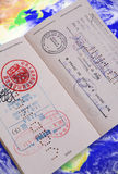 Passaporte no globo Imagens de Stock Royalty Free