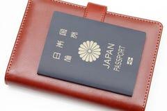 Passaporto giapponese isolato su fondo bianco Immagini Stock