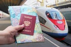 Passaporto russo con una mappa sui precedenti del trai ad alta velocità Immagini Stock Libere da Diritti