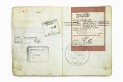 Passaporto straniero con i bolli britannici di un'immigrazione Fotografie Stock