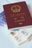 Passaporto su soldi Fotografia Stock Libera da Diritti