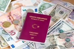 Passaporto turco sugli euro, sui dollari e sulla valuta turca Fotografia Stock Libera da Diritti