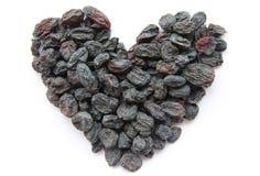 Passas - frutos secados sob a forma do coração Foto de Stock Royalty Free