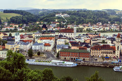 Passau in Germany. A panoramic shot of Passau, Germany. In the foreground the Danube, in the background the Inn and here between the old historic center of Stock Image