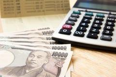 Passbok сберегательного счета, японская иена, калькулятор Стоковое фото RF