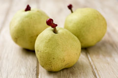 Passe crassane pears on a table Royalty Free Stock Photos