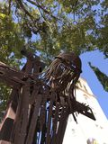 Passe a escultura de Jesus Christ que pendura em uma cruz em Miami, Florida Fotos de Stock Royalty Free
