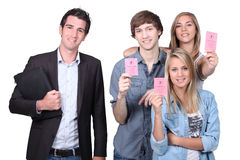 Passed driving test. Group of teenagers have passed their driving test stock photos