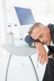 Passed out businessman in his office Royalty Free Stock Photos