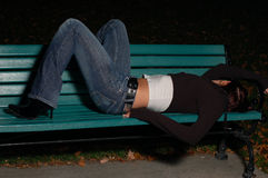 Passed-out girl on a park bench. This park is located in Longueuil, Canada. Camera: D50, Lens: nikkor 50mm, external flash with umbrella Royalty Free Stock Photography